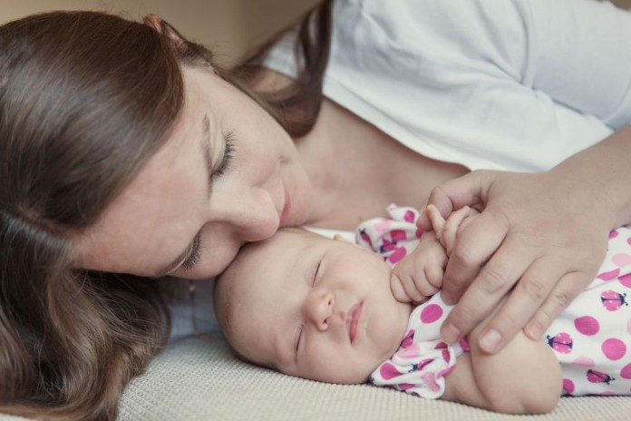mom sleeping with baby